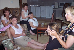 Emma (far right) leads a training session in head massage.