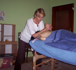 Emma administers individual cranial-sacral therapy.